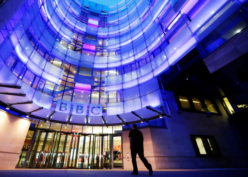 FILE PHOTO: A man enters BBC New Broadcasting House in London