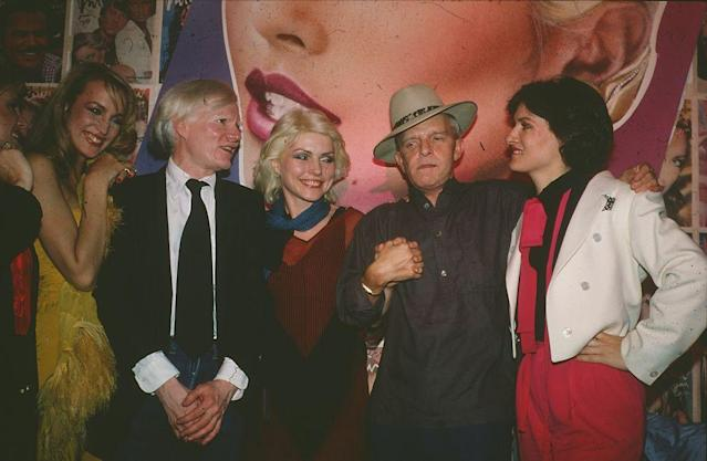 From left to right: Jerry Hall, Andy Warhol, Debbie Harry, Truman Capote, and Paloma Picasso celebrate <em>Interview</em> magazineat Studio 54 in June 1979. (Photo: Sonia Moskowitz/Getty Images)