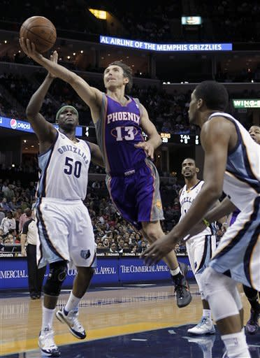 Phoenix Suns guard Steve Nash (13) drives between Memphis Grizzlies defenders Zach Randolph (50), Mike Conley, back, and Rudy Gay in the first half of an NBA basketball game Wednesday, April 11, 2012, in Memphis, Tenn. (AP Photo/Lance Murphey)