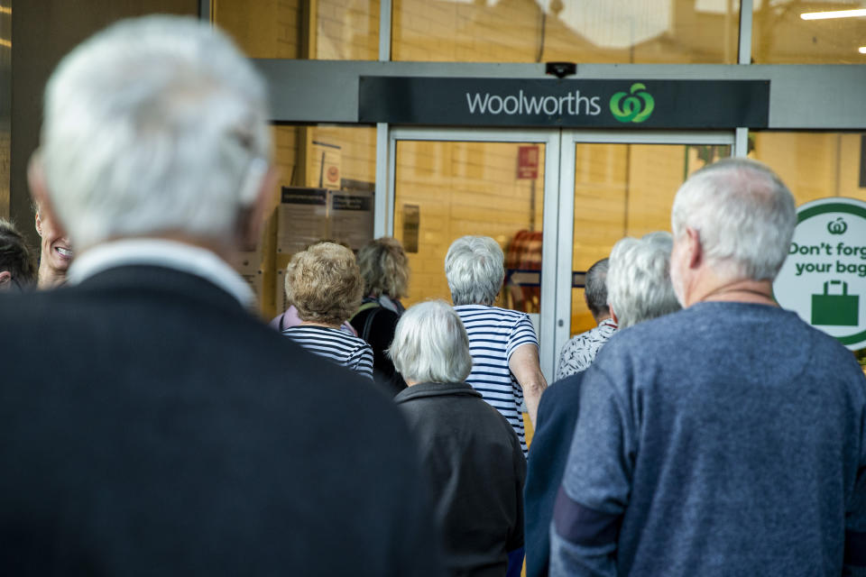 People are seen waiting for the opening of Woolworths supermarket in Balmain on March 17, 2020 in Sydney, Australia.
