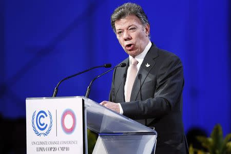 Colombia's President Santos delivers a speech during the High Level Segment of the U.N. Climate Change Conference COP 20 in Lima