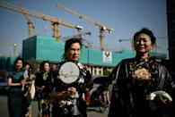 """The """"Fashion Grandmas"""" dressed in traditional costumes during a rehearsal for a performance on a television show in Beijing"""