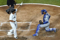 Chicago White Sox's Jose Abreu, left, celebrates after hitting a solo home run as Kansas City Royals catcher Salvador Perez looks to the field during the fourth inning of a baseball game in Chicago, Saturday, May 15, 2021. (AP Photo/Nam Y. Huh)