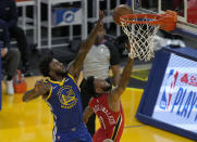 Golden State Warriors' Jordan Bell (20) blocks New Orleans Pelicans guard Nickeil Alexander-Walker (6) during the first half of an NBA basketball game on Friday, May 14, 2021, in San Francisco. (AP Photo/Tony Avelar)
