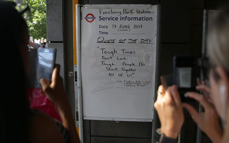 Commuters take pictures of the board at Finsbury Park station - Credit: DANIEL LEAL-OLIVAS/AFP