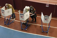 Voters mark their ballots during early voting at the Park Slope Armory YMCA, Tuesday, Oct. 27, 2020, in the Brooklyn borough of New York. (AP Photo/Mary Altaffer)