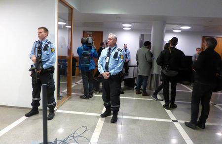 Armed police guard the courtoom in Oslo District Court, where a judge is deciding on the detention of a 17-year-old Russian, suspected of planting a bomb-like device on Saturday, in central Oslo, Norway April 10, 2017. REUTERS/Gwladys Fouche