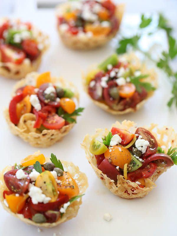 """<strong>Get the <a href=""""http://www.foodiecrush.com/2013/08/heirloom-tomato-frico-cups/"""" rel=""""nofollow noopener"""" target=""""_blank"""" data-ylk=""""slk:Heirloom Tomato Frico Cups recipe"""" class=""""link rapid-noclick-resp"""">Heirloom Tomato Frico Cups recipe</a> from Foodie Crush</strong>"""