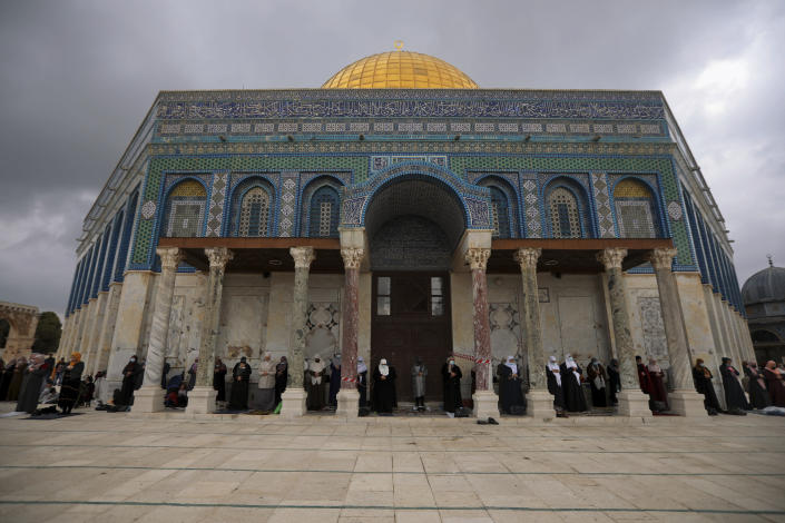 """Muslim women gather for Friday prayer, next to the Dome of the Rock Mosque in the Al Aqsa Mosque compound in Jerusalem's old city, Friday, Nov. 6, 2020. The Palestinian leadership has condemned the United Arab Emirates' decision to forge ties with Israel as a """"betrayal,"""" but it could lead to a tourism bonanza for Palestinians in east Jerusalem as Israel courts wealthy Gulf travelers. (AP Photo/Mahmoud Illean)"""