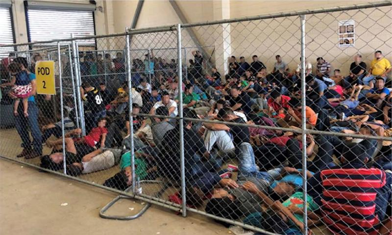 An overcrowded fenced area holding families at a Border Patrol station is seen in a still image from video in McAllen, Texas, U.S. on June 10, 2019 and released as part of a report by the Department of Homeland Security's Office of Inspector General on July 2, 2019. Picture pixelated at source. (Photo: Office of Inspector General/DHS/Handout via Reuters)