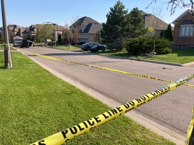 Officers saida blackMercedes Benz struck three people who were in a driveway, including an 11-year-old girl and her 4-year-old brother.  (Mark Bochsler/CBC - image credit)