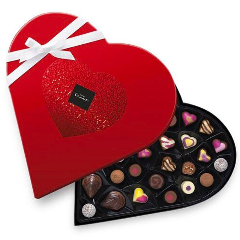 """<p><a class=""""link rapid-noclick-resp"""" href=""""https://go.skimresources.com?id=127X678080&xs=1&url=https%3A%2F%2Fwww.hotelchocolat.com%2Fuk%2Fshop%2Fvalentines-day-gifts%2Fstraight-from-the-heart-valentine-chocolates.html%23shownresults%3D21%26backpid%3Dstraight-from-the-heart-valentine-chocolates%26start%3D8"""" rel=""""nofollow noopener"""" target=""""_blank"""" data-ylk=""""slk:SHOP"""">SHOP</a></p><p>A combination of Champagne truffles, caramels, cocktails, fruity twists, pralines, and more, this box is worthy of any rom-com. </p><p>£40, Hotel Chocolat</p>"""