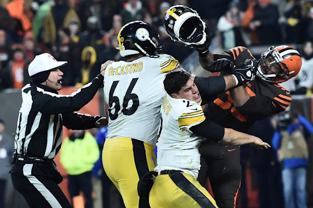 Browns defensive end Myles Garrett (95) hits Pittsburgh Steelers quarterback Mason Rudolph (2) with his own helmet as offensive guard David DeCastro (66) tries to stop Garrett. (Ken Blaze/USA TODAY Sports)