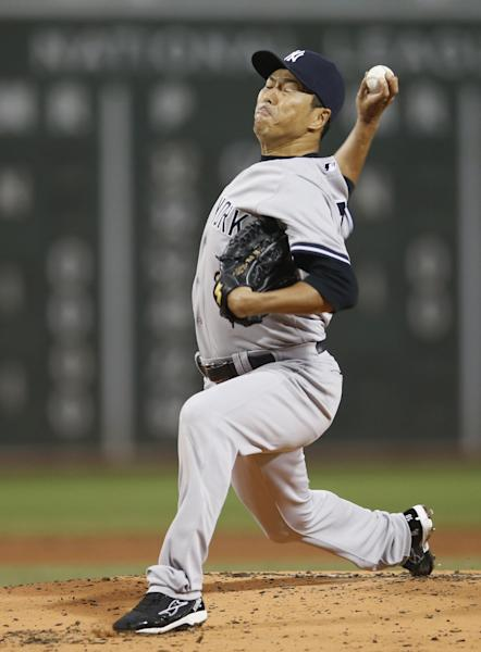 New York Yankees starting pitcher Hiroki Kuroda throws to a Boston Red Sox batter in the first inning of a baseball game at Fenway Park in Boston on Friday, Sept. 13, 2013. (AP Photo/Elise Amendola)
