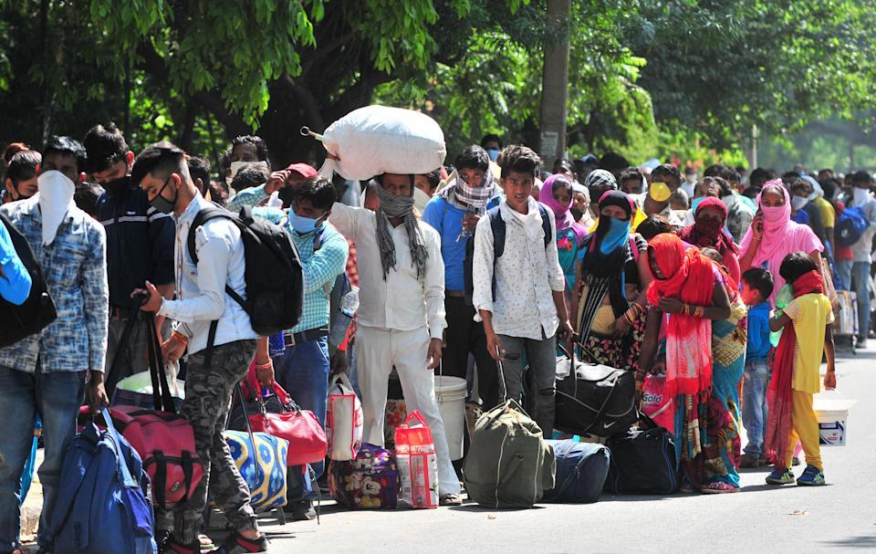 CHANDIGARH, INDIA - MAY 27: Migrants gathered to register for Shramik Special trains at Chandigarh College of Engineering and Technology (CCET) at Sector 26 on May 27, 2020 in Chandigarh, India. (Photo by Ravi Kumar/Hindustan Times via Getty Images)