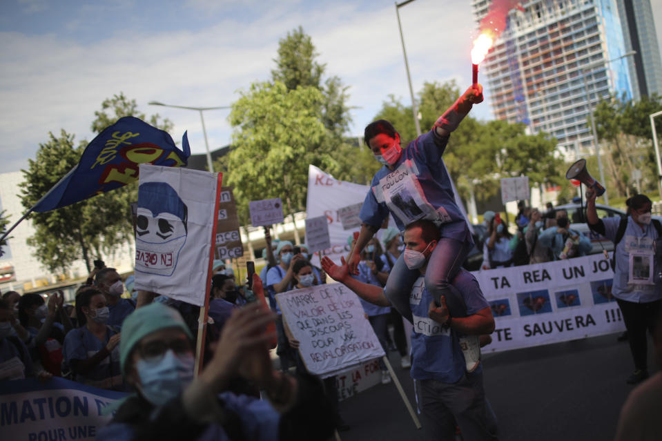 Striking ICU nurses demonstrate in Marseille, southern France, Tuesday, May, 11, 2021 to demand better pay and working conditions as the government gradually reopen the country. (AP Photo/Daniel Cole)