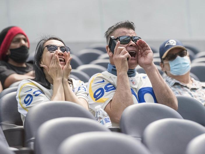 Rams season ticket holders Jamella and Steve Munoz sit in their seats for the first time at SoFi Stadium in Inglewood.