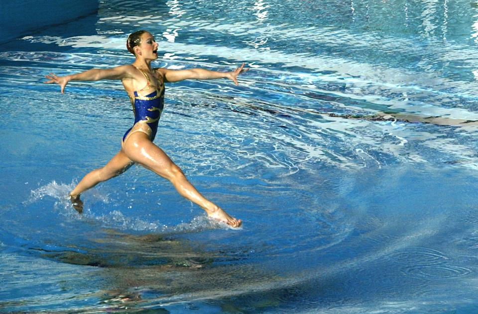 A member of the Ukrainian synchronised swimming team performs its free routine during an Olympic Games qualification tournament at the Olympic Aquatic Centre of the Athens Olympic Sports Complex (OAKA) April 17, 2004. REUTERS/Yannis Behrakis Pictures of the Year 2004  YB/GB - RP4DRIATKIAA