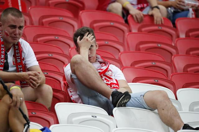 Soccer Football - World Cup - Group H - Poland vs Colombia - Kazan Arena, Kazan, Russia - June 24, 2018 Poland fan looks dejected at the end of the match REUTERS/Toru Hanai