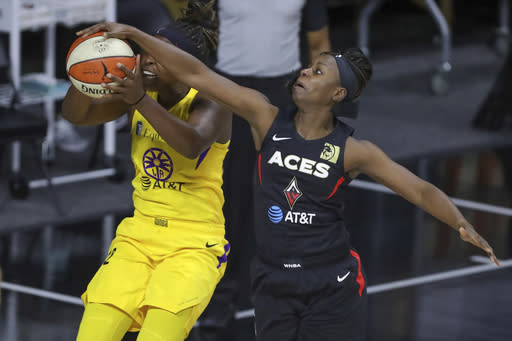 Las Vegas Aces' Sugar Rodgers, right, blocks a shot attempt by Los Angeles Sparks' Chelsea Gray during the first half of a WNBA basketball game Saturday, Sept. 12, 2020, in Bradenton, Fla. (AP Photo/Mike Carlson)