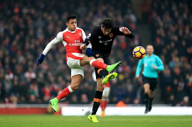 <p>Arsenal's Alexis Sanchez (left) and Hull City's Andrea Ranocchia battle for the ball </p>