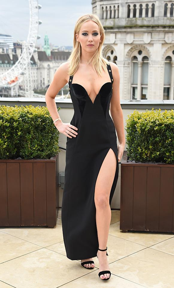 <p>The <em>Red Sparrow </em>star continued to kill the fashion game while doing press for the new flick. On Tuesday, at photocall in London, Jen went for a sexy, plunging black gown, with a slit up to her hip. (Photo: David M. Benett/Dave Benett/Getty Images) </p>