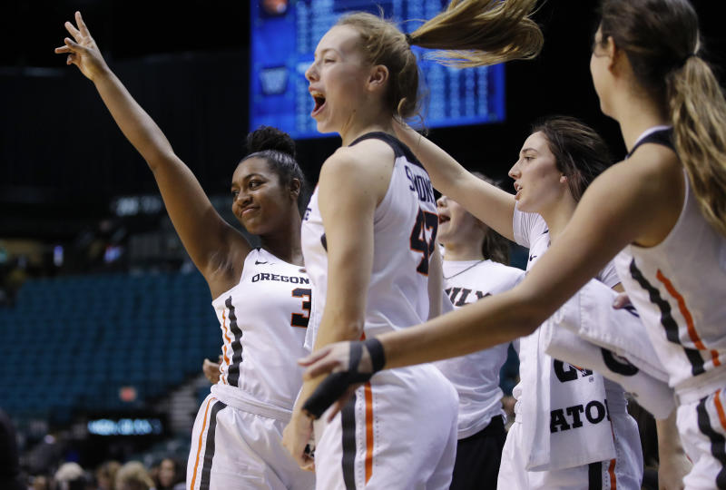 FILE - In this March 8, 2019, file photo, Oregon State's Madison Washington, left, celebrates with teammates during the second half of an NCAA college basketball game against Oregon State at the Pac-12 women's tournament in Las Vegas. Thirteenth-seeded Boise State (28-4) looks for its first-ever NCAA Tournament win on Saturday, March 23, 2019, against No. 4 seed Oregon State (24-7) at Gill Coliseum in Corvallis, the Broncos' opening step in the Albany Regional. Fifth-seeded Gonzaga (28-4) faces No. 12 Little Rock (21-10) in the other game. (AP Photo/John Locher, File)