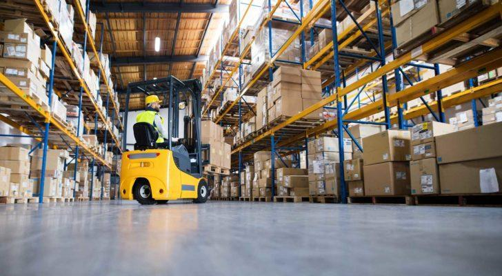 Image of a man driving a forklift in a warehouse.