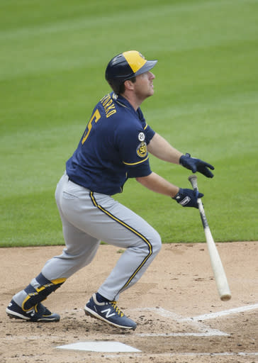 Milwaukee Brewers' Jedd Gyorko (5) hits a solo home run against the Detroit Tigers during the third inning of a baseball game Wednesday, Sept. 9, 2020, in Detroit. (AP Photo/Duane Burleson)