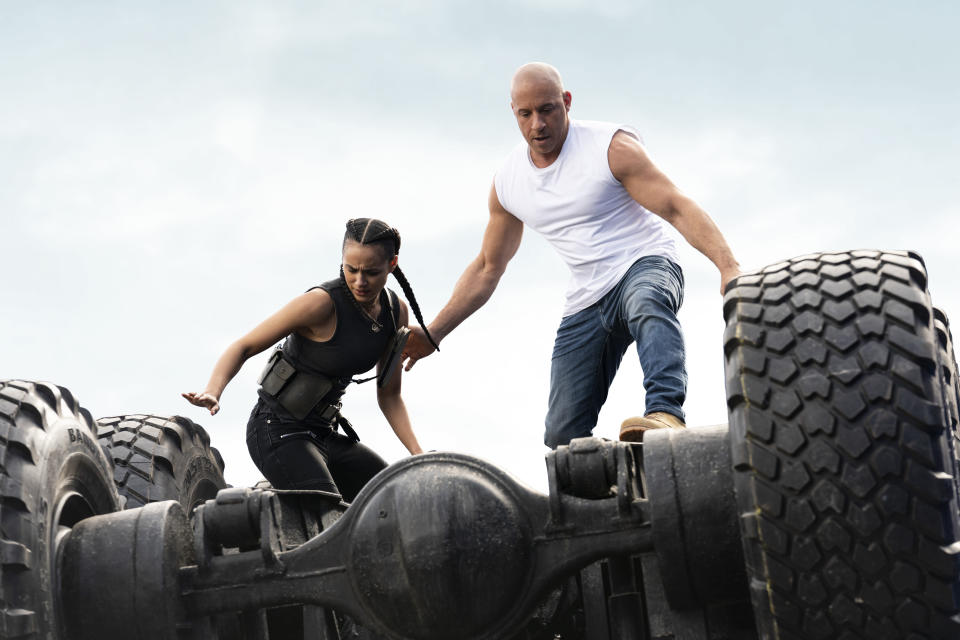 """This image released by Universal Pictures shows Nathalie Emmanuel, left, and Vin Diesel in a scene from """"F9: The Fast Saga."""" (Giles Keyte/Universal Pictures via AP)"""