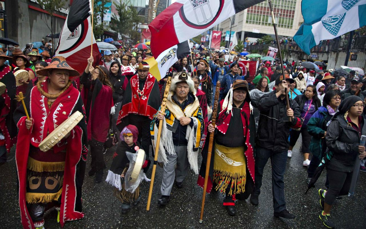 First Nations' people in traditional dress take part in a Truth and Reconciliation march in Vancouver, British Columbia September 22, 2013. First Nations people, many survivors of the abuse at former Canadian Government Indian Residential Schools, have been meeting for the past week. REUTERS/Andy Clark (CANADA - Tags: SOCIETY POLITICS)