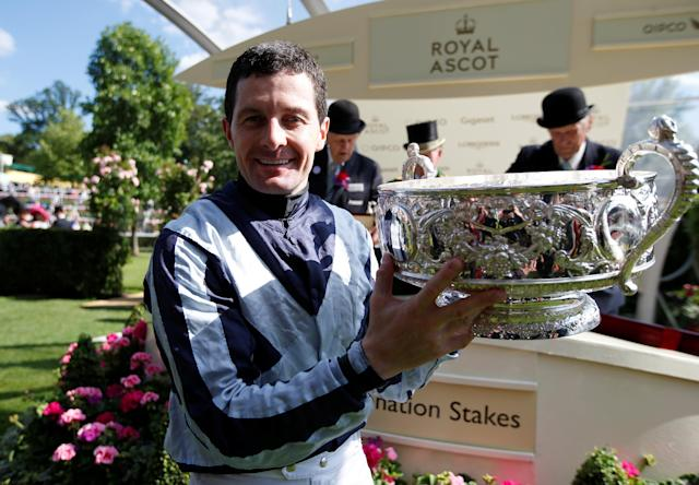 Horse Racing - Royal Ascot - Ascot Racecourse, Ascot, Britain - June 22, 2018 Colm O'Donoghue poses as he celebrates winning the 4.20 Coronation Stakes on Alpha Centauri with the trophy Action Images via Reuters/Paul Childs