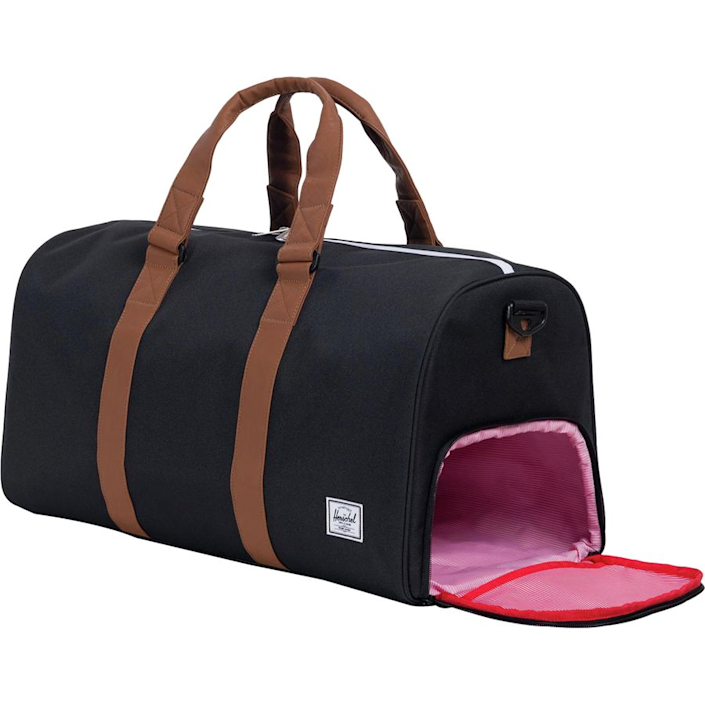 """<strong><h3>Herschel Novel Mid-Volume Duffel</h3></strong><br>Longer weekends away call for a duffle bag with ample space for rolling and stuffing all the travel necessities — this compact option blends utility with style to cover multiple days away.<br><br><em>Shop </em><strong><a href=""""https://www.backcountry.com/herschel-supply"""" rel=""""nofollow noopener"""" target=""""_blank"""" data-ylk=""""slk:Herschel"""" class=""""link rapid-noclick-resp""""><em>Herschel</em></a></strong><br><br><strong>Herschel Supply Co.</strong> Novel Mid-Volume Duffle, $, available at <a href=""""https://go.skimresources.com/?id=30283X879131&url=https%3A%2F%2Fwww.backcountry.com%2Fherschel-supply-novel-mid-volume-33.5l-duffle"""" rel=""""nofollow noopener"""" target=""""_blank"""" data-ylk=""""slk:Backcountry"""" class=""""link rapid-noclick-resp"""">Backcountry</a>"""