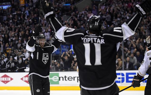 Los Angeles Kings center Jeff Carter, left, celebrates his goal with center Anze Kopitar, of Slovenia, during the second period in Game 3 of an NHL hockey second-round Stanley Cup playoff series against the Anaheim Ducks, Thursday, May 8, 2014, in Los Angeles. (AP Photo/Mark J. Terrill)