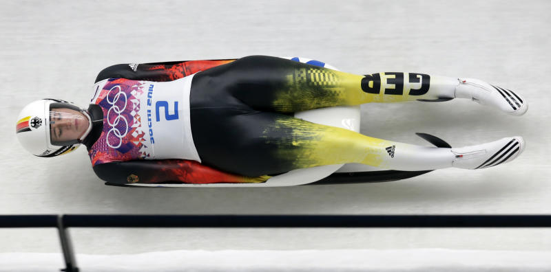 Natalie Geisenberger of Germany speeds down the track in her first run during the women's singles luge competition at the 2014 Winter Olympics, Monday, Feb. 10, 2014, in Krasnaya Polyana, Russia. (AP Photo/Michael Sohn)
