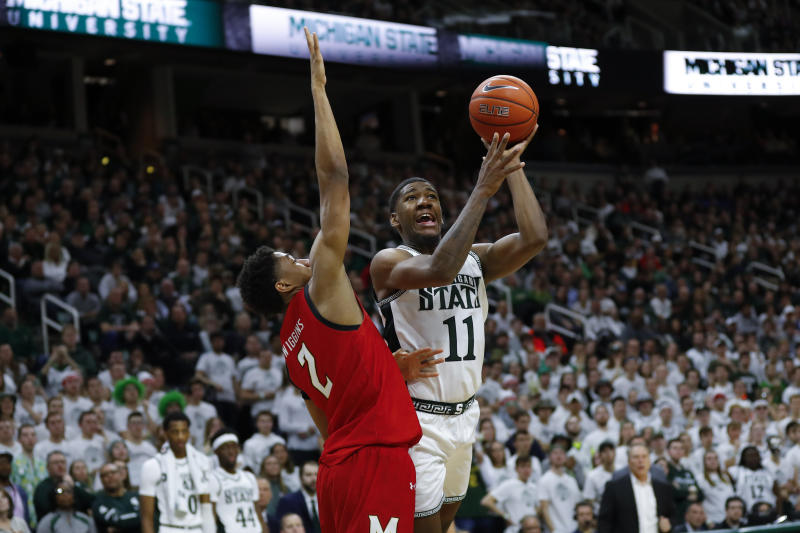 Michigan State forward Aaron Henry (11) shoots on Maryland guard Aaron Wiggins (2) in the second half of an NCAA college basketball game in East Lansing, Mich., Saturday, Feb. 15, 2020. (AP Photo/Paul Sancya)