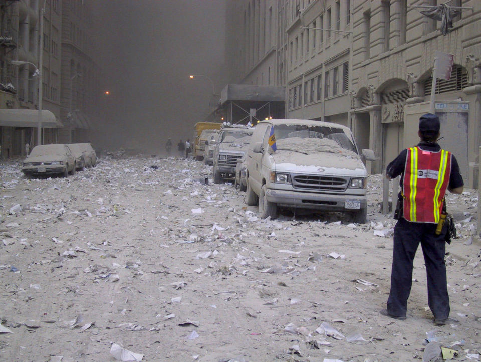 Ash covers a street in downtown New York City after the collapse of the World Trade Center following a terrorist attack Tuesday, Sept. 11, 2001. (AP Photo/Bernadette Tuazon)