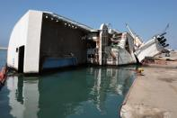 A capsized ship is seen at Beirut port