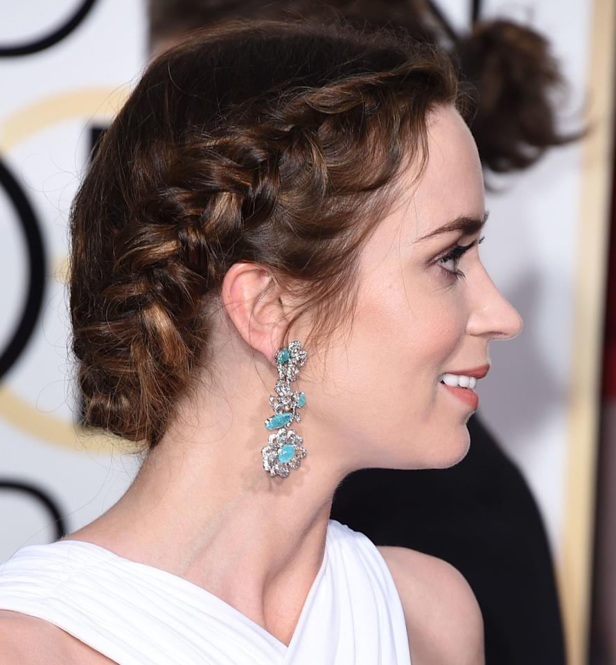 <p>Copy the queen of romantic braided updos, Emily Blunt, by opting for a French braid on either side, before bringing the two together in a twisted chignon at the back.</p>
