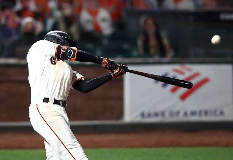 SAN FRANCISCO, CALIFORNIA - JULY 29: Mike Yastrzemski #5 of the San Francisco Giants hits a walk off home run in the ninth inning against the San Diego Padres at Oracle Park on July 29, 2020 in San Francisco, California. (Photo by Ezra Shaw/Getty Images)