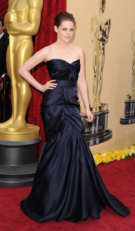 """Kristen Stewart   Grade: A+    The """"Twilight"""" sourpuss looked much less awkward than usual in a stunning strapless midnight blue Monique Lhuillier gown. Kristen topped off her look with a classy diamond bracelet by H. Stern."""