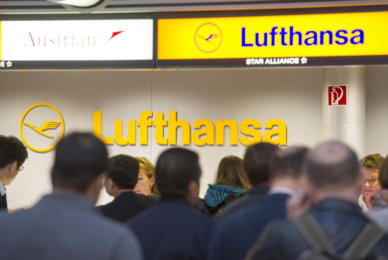 Passengers wait in front of a Lufthansa counter in Hamburg, northern Germany, Friday, Sept. 7, 2012. Lufthansa canceled about two-thirds of its flights Friday after flight attendants walked off the job at airports around the country in an escalating battle with Germany's largest airline, but signs emerged that the two sides may be prepared to return to the negotiating table. (AP Photo/dapd, Olaf Malzahn)