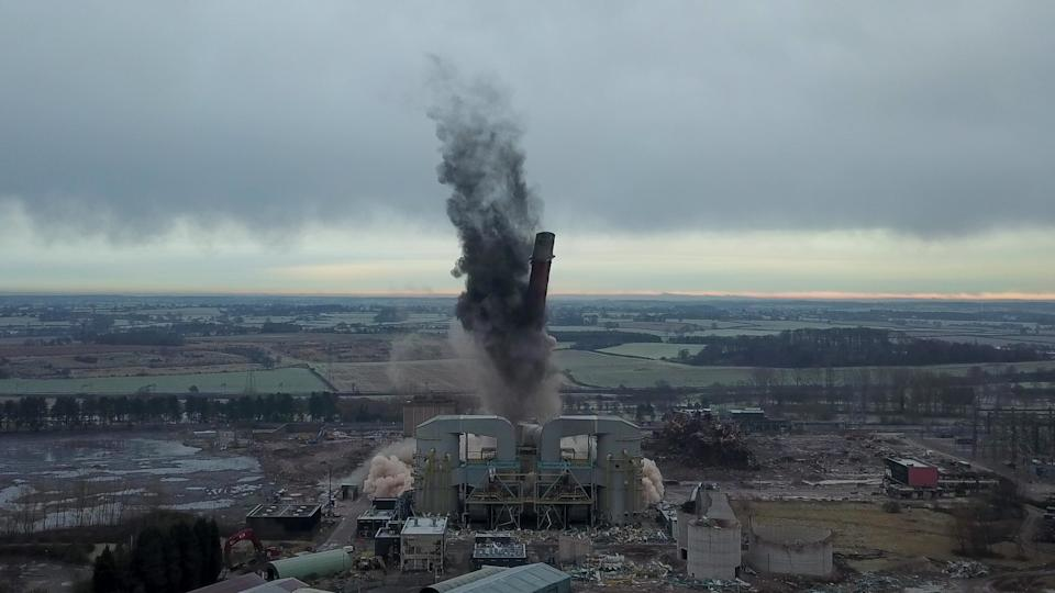 Dozens of spectators gathered to watch the dramatic moment a 183-metre (600ft) tall iconic power station chimney was demolished in a controlled explosion. The imposing concrete tower at Rugeley Power Station collapsed in just four seconds in a cloud of dust. Between 50 and 100 residents gathered on a nearby hillside to watch the spectacle unfold despite police warning people to avoid travelling to the area during lockdown. The massive chimney was demolished using explosive charges to pave the way for new development in the area - including hundreds of homes, a school and offices.