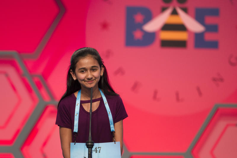"""FILE - In this May 31, 2018 file photo, Naysa Modi, 12, from Frisco, Texas, spells her word incorrectly during the evening finals of the Scripps National Spelling Bee in Oxon Hill, Md. An unremarkable sound can be the toughest thing for spellers to master at the Scripps National Spelling Bee. It's known as the schwa. It sounds like """"Uh,"""" and any vowel can make the sound. Spellers have a variety of techniques to figure out unfamiliar schwas, but none of the strategies is foolproof, and sometimes the only things to do are to memorize the word or guess. (AP Photo/Cliff Owen)"""