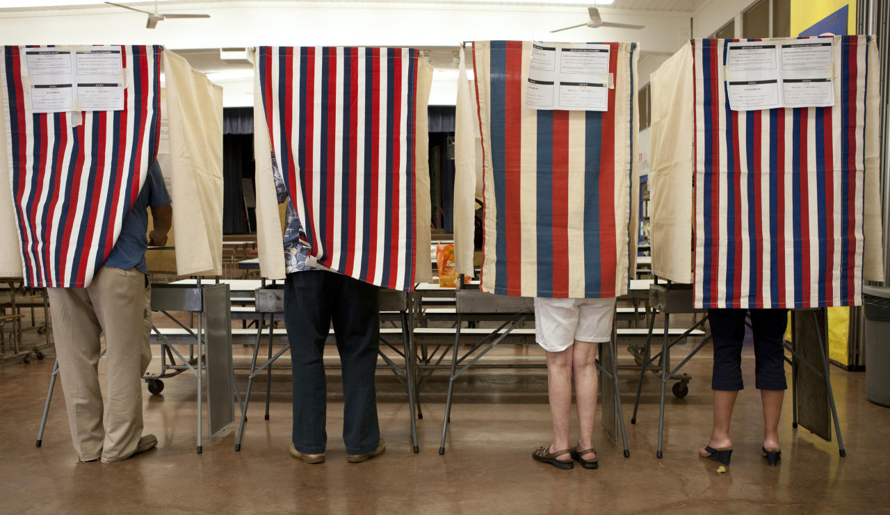 Voters cast their ballots at Waikiki Elementary on Election Day, Tuesday, Nov. 6, 2012 in Honolulu. (AP Photo/Marco Garcia)