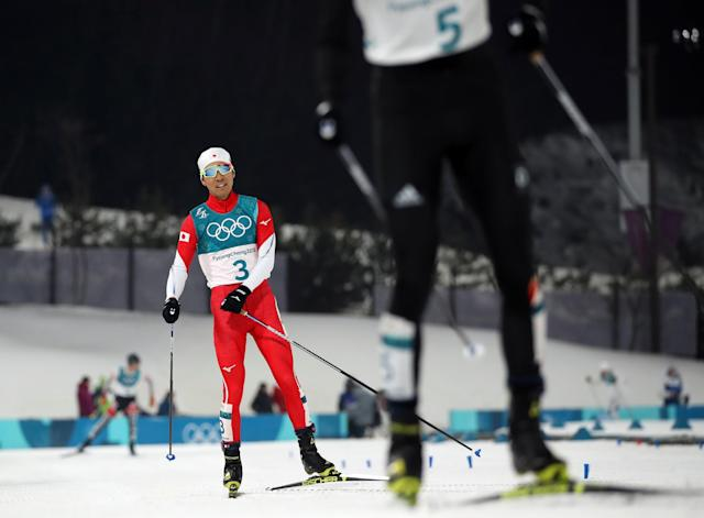 Nordic Combined Events – Pyeongchang 2018 Winter Olympics – Men's Individual 10km Final – Alpensia Cross-Country Skiing Centre - Pyeongchang, South Korea – February 14, 2018 - Akito Watabe of Japan reacts behind Eric Frenzel of Germany. REUTERS/Carlos Barria
