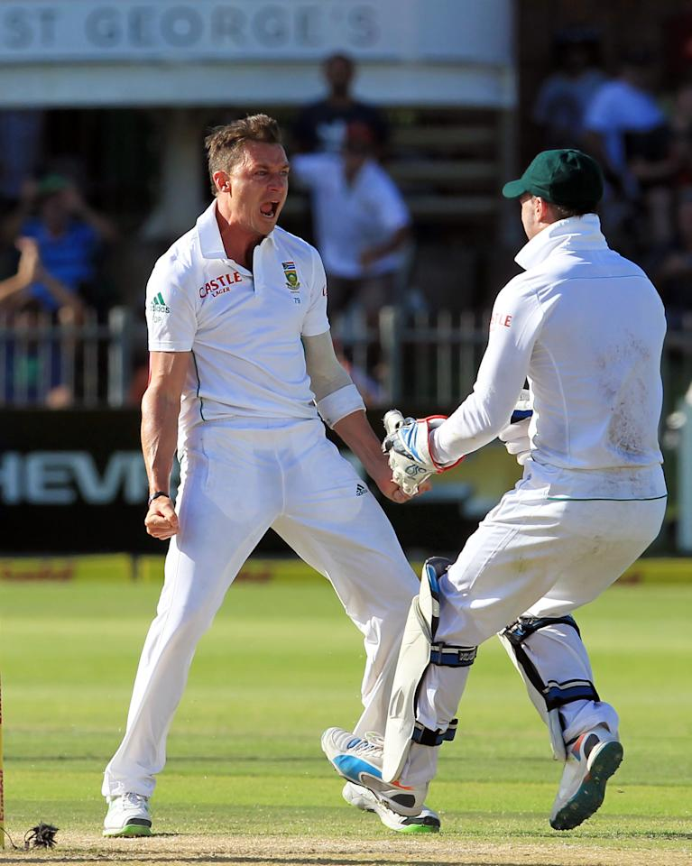 South Africa's bowler Dale Steyn, left, celebrates with teammate AB de Villiers, right, after dismissing Australia's captain Michael Clarke, left, for 1 run on the fourth day of their 2nd cricket test match at St George's Park in Port Elizabeth, South Africa, Sunday, Feb. 23, 2014. (AP Photo/ Themba Hadebe)