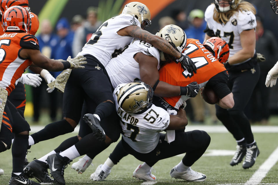Cincinnati Bengals quarterback Andy Dalton (14) is sacked by New Orleans Saints defensive end Alex Okafor (57) in the first half of an NFL football game, Sunday, Nov. 11, 2018, in Cincinnati. (AP Photo/Gary Landers)
