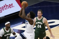 Minnesota Timberwolves' Anthony Edwards (1) lays the ball up as Milwaukee Bucks' Pat Connaughton (24) and Bobby Portis (9) watch during the second half of an NBA basketball game Wednesday, April 14, 2021, in Minneapolis. (AP Photo/Jim Mone)
