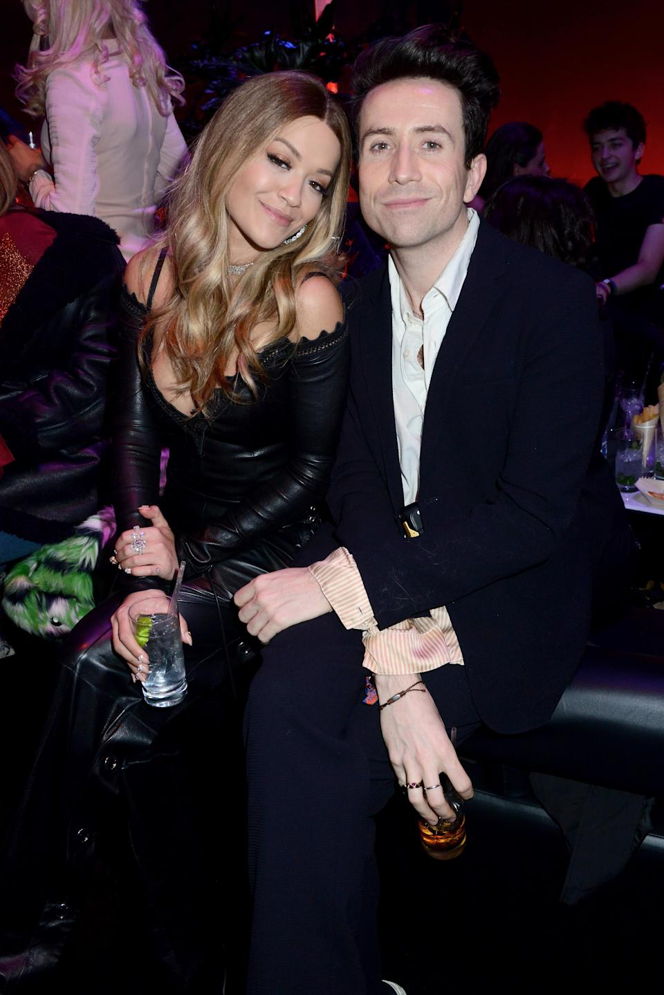 <p>For the after show party, Rita posed with Radio 1's Nick Grimshaw wearing a plunging black leather dress. <em>[Photo: Getty]</em> </p>